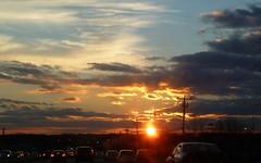 Sunset over Long Island (en tee gee) Tags: sunset ny newyork cars longisland vision:sunset=0934 vision:car=0525 vision:sky=0986 vision:ocean=0525 vision:clouds=0976