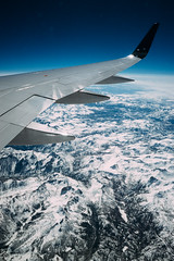 Passing The Rocky Mountains (Fredrik Forsberg) Tags: snow airplane view unitedstates nevada flight wing rockymountains icy sonya7