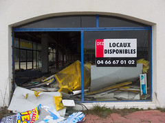 Plundered discount shop (=Nahemoth= (absent for a while)) Tags: street shop closed olympus business destroyed nmes xz10