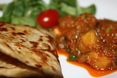 Chicken crurry served with chapati and salad (WorldClick) Tags: food chicken canon eos photo salad yummy flickr photographer with indian spice salt powder east photograph delight served pakistani chilli turmeric cumin eastern haldi flavour cusine jeera chapati phototgraphy dhaniya 1100d zeera crurry canoneos1100d chickencrurryservedwithchapatiandsalad worldclick