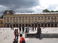 P5290585 (lnewman333) Tags: plaza sky people latinamerica southamerica birds architecture clouds square colombia bogota pigeons historic simonbolivar cundinamarca plazadebolivar lacandelaria bolivarsquare