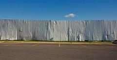 Scrapyard Cloud (JeffStewartPhotos) Tags: ontario canada fence steel fencing junkyard scrapyard bent damaged peterborough corrugated dented corrugatedsteel