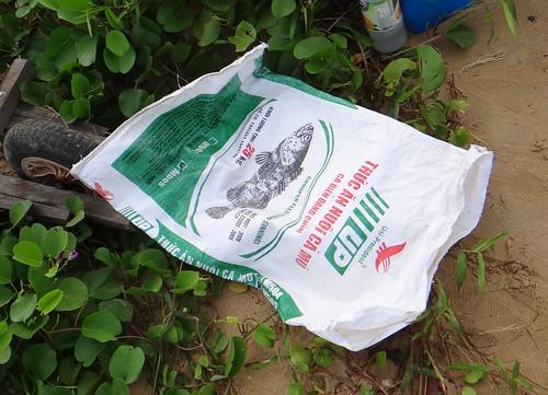 Trashy Pasir Ris beach: Fish meal bag