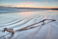 Driftwood at Camber Sands (Annavr6Photography) Tags: wood uk longexposure sunset sea sky sun seascape beach water clouds canon landscape kent sand waves tripod cambersands driftwood manfrotto camber tripos 5d2 canon5d2 canon5dmkll uploaded:by=flickrmobile flickriosapp:filter=nofilter