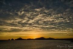 Cabo sunset (Eugene Kogan) Tags: ocean sunset sea sky orange mountains cabo sailing ricoh ricohgr cabosanlucas sunsetdamonalisa
