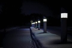 Lamps In Line (k009034) Tags: street longexposure travel winter light snow beautiful night canon finland photography eos 350d lights lowlight nightlights post path footprints line nighttime rebelxt beautifulearth oulainen