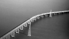Bridge over the Bay (shardtor) Tags: ocean sanfrancisco california bridge tower lines bay fly airport power sfo aerial landing pacificocean toll eastbay hayward approach pylons peninsula sanmateo sanmateobridge sanmateohaywardbridge