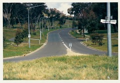 Pathway crossing Longmore Crescent at Gaunson Crescent. View from roadway centre. c1989 (ArchivesACT) Tags: canberra bikepaths cyclepaths wanniassa