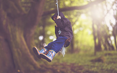 Swinging (Wojtek Piatek) Tags: blue ireland boy forest fun woods dof bokeh rope swing jacket flare shallow swinging wellies ropeswing zeiss135 sonya99