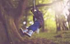 Swinging (Wojtek Piatek) Tags: blue ireland boy forest fun woods dof bokeh rope swing jacket flare shallow swinging wellies ropeswing zeiss135 sonya99