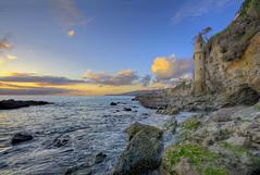 Sunset at Victoria Beach (Non Paratus) Tags: tour latour lagunabeach orangecounty beach rocks shore coast sky clouds surf water sunsets seascape cliffs