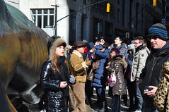 Attraction (Smith-Bob) Tags: street nyc winter people usa ny newyork statue bronze america us candid bull tourists nyse wallst bowlinggreenpark chargingbull arturodimod