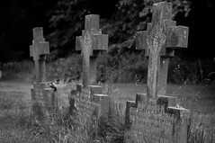 Crooked crosses (Stickyemu) Tags: old bw church grave graveyard stone blackwhite cross headstone nikond90 nikondxafs35mm18