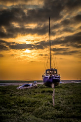 (Nathalie Saleh) Tags: uk sunset sea england orange seascape grass clouds liverpool landscape boat united kingdom land scape wirral sheldrakes vision:mountain=0515 vision:sunset=0944 vision:sky=0976 vision:clouds=0911 vision:outdoor=0649