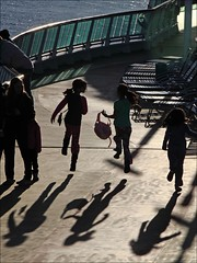 """Airborne"" - Radiance of the Seas, Alaska (TravelsWithDan) Tags: silhouette alaska children boat ship joy excited cruiseship airborne radianceoftheseas royalcaribbeancruiseline worldtrekkerngckidscandidstreet photographyaboard"