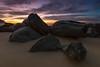 D o w n W i t h T h e L o t (just goes to show ~ Rob) Tags: ocean sun beach sunrise sand rocks boulders nsw sinking forresters