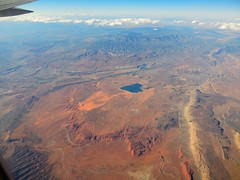 High over the west on a 757-200 (Jim Mullhaupt) Tags: red wallpaper arizona orange mountain newmexico window yellow rock airplane landscape utah colorado flickr butte desert jet canyon fourcorners windowseat mullhaupt jimmullhaupt