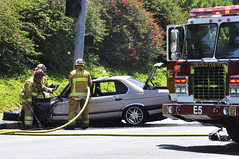 Firefighters with the Orange County Fire Authority overhaul contents of a vehicle fire. OCFA Engine 5 (bharer75) Tags: california county orange car fire highway crash authority chp mission laguna viejo department patrol pursuit collision sheriffs niguel ocsd sdge ocfa