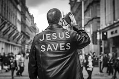 An Unholy Racket (Leanne Boulton) Tags: streetphotography monochrome people urban street candid portrait candidstreetphotography candidportrait streetlife socialdocumentary man male back leather jacket expression gesture preach preaching preacher jesus religion religious performer isolation shouting bible tone texture detail depthoffield bokeh storytelling naturallight outdoor light shade city scene human life living humanity society culture canon canon5d 5dmkiii 70mm character ef2470mmf28liiusm black white blackwhite bw mono blackandwhite glasgow scotland uk
