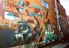 Trash Panda Artist (Georgie_grrl) Tags: marchmontrealmission 50thbirthdaytrip withgeetha celebration party adventure montreal quebec pentaxk1000 rikenon12828mm cinestillfilm800tungsten mural graffiti artwork