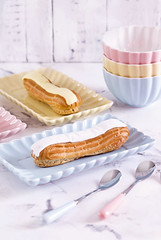 French confectionery, pink and white Eclair (♥Oxygen♥) Tags: background eclaire bake biscuit breakfast cafe cake calorie chic choux confection cookie cream cuisine delicious dessert eat eclairs fattening filling food french gastronomy pastry shabby snack stuffed sugar sweet tabletop tasty treat unhealthy vanilla vintage violet whipped blue pastel pink tender light eclair dish still high giant pudding palte marble
