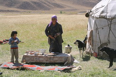 Semi Nomadic Kyrgyz Mother and Daughter Yurt Summer Grazing  Pastures Kyrgyzstan Central Asia (eriagn) Tags: people mother daughter yurt dog textile summerpasture seminomadic polaroid photographs landscape grass grasslands crockery bowls yogurt samovar water food sheepskin felt insulated warm shelter traditionaltextile woman girl asia centralasia kyrgyzstan tunduk mountain frame wood sticks portable eriagn canon travel traditional nomad nomadic gettyimages shadows ngairelawson travelphotography structure texture blue sky summer awesomeasia mountainous agriculture tianshan silkroad threadsinthesand ethnic kyrgyz summerpastures tunduck handcrafted curve dwelling portabledwelling ngairehart eos