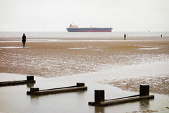 Another place (marktmcn) Tags: another place group sculpture sculptures crosby beach antony gormley cast iron standing figures facing sea looking seaward ship passing wooden structures tidal coast water dsc rx100 liverpool bay