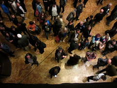 Photographer with hat (shaggy359) Tags: above people london hat concert photographer audience crowd watching barbican clinic milling wacth