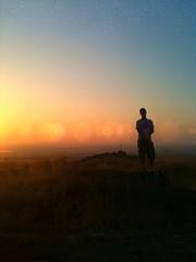 Not Quite Vegas (ishootreno) Tags: sunset portrait sky orange brown selfportrait black grave silhouette stars landscape cross desert horizon roadtrip ios 2011 nightfx skyporn lenslight iphoneography iphone4s photoforge2 snapseed unitedbyedit uploaded:by=flickrmobile flickriosapp:filter=nofilter