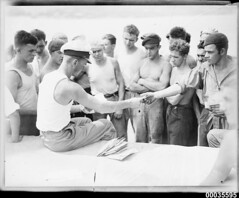 Officer distributing mail to the crew of MAGDALENE VINNEN