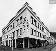 Cornered (Sigurdur William Photography) Tags: street bw white black sign corner iceland store cloudy horn crossroads paved htel isafjordur