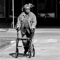 P1060561 (Akbar Simonse) Tags: street people urban bw woman holland blancoynegro netherlands monochrome glasses zwartwit candid nederland streetphotography denhaag bn thehague bril streetshot straat rollator lahaye sgravenhage straatfotografie straatfoto