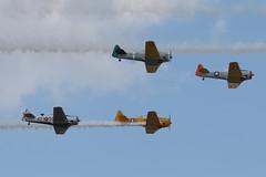North American T-6 Texan's - part of the daily airshow at Sun 'n Fun 2013 (egcc) Tags: display harvard formation airshow lakeland snf texan t6 lal klal sunnfun northamerican linder 2013 n645ds n8201v n651sh n42gk
