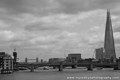 On The Thames (myrealeye photography) Tags: bridge sky blackandwhite bw water thames clouds skyscraper towerbridge londonbridge river shard