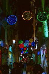 Christmas Las Ramblas (beticoman) Tags: barcelona city las light urban color colour film night 35mm lights shadows kodak iso400 g rangefinder olympus iso 400 35 zuiko ramblas analogic olympus35sp ultramax 35sp 42mm telemetrica plustek plustek7600