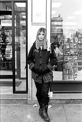 Punk Girl (giovannagrueiro) Tags: city nyc newyorkcity portrait newyork vertical outside punk 2000 day boots manhattan unitedstatesofamerica thecity teenagers sidewalk teen punkrocker blond storefront northamerica daytime recordstore eastcoast blackhoodie punkgirl