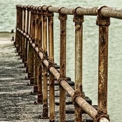 Rusty railings (El Tel63, Photographer & Phantom flyer) Tags: texture coast rust rusty railings eastsussex seaford breakwater seafordhead canon24105mml canon50d eltel63