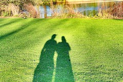 Shadows (PinkboxxPhotography) Tags: park shadow sea green love nature river person see shadows pair natur lawn paar wiese lovers grn fluss schatten liebe rasen personen prchen uploaded:by=flickrmobile colorvibefilter flickriosapp:filter=colorvibe