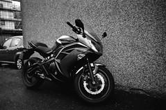 Kawasaki (Ilford XP2 Super 400 14) (AngusInShetland) Tags: blackandwhite bw film 35mm scotland motorbike xp2 ilford shetland lerwick kawasaki xp2super400 er6f canoscan5600f kawasakier6f ilfordsingleuse