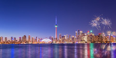 Toronto Skyline in Bluehour (Purvesh Trivedi -www.purveshtrivediphotography.com) Tags: yyz toronto explorecanada travel rogerscentre cntower centreisland skyline downtown nightlife fireworks bluehour buildings lake canada ontario visitcanada