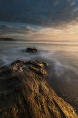 The sun dyes gold the rocks (jojesari) Tags: ar117g 12414 major playademajor sanxenxo pontevedra galicia sunset atardecer solpor puestadesol ocaso jojesari suso océanoatlantico explore