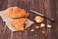 croissant and knife for breakfast on a dark wooden table (♥Oxygen♥) Tags: food croissant table breakfast dark wooden drink view brown top fast bun coffee aroma snack confection brioche texture pastry vintage cooking baked hot plate delicious sweet cup morning mug culinary espresso appetizer space dessert life break still desk beans beverage white yellow cappuccino closeup tea winter art shop decoration crumbs knife