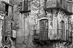 """SICILIAN MEDIEVAL FACADE"" © by Silva Wischeropp aka Silva Capitana (SILVA CAPITANA) Tags: sicilianmedievalfacade medievalfacade facade sicily isleofsiciliy italy architecture oldwall urban urbanlandscape islandsicily abstract blackandwhite black white grey mono monochrome mountainvillage forzadagro middlleage oldarchitecture southofitaly island windows balcony sicilianbalcony house oldhouses door sicilianarchitecture abstraction italiancharme photography photo cityscape cityshape town sicilianhouses urbanabstraction isleofsicily isle southitaly monochromeart duplex middleage blackwhite houses wall building"