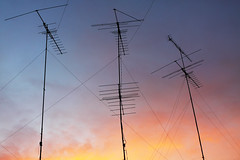 antennas (Nuch_>cha) Tags: roof sunset red sky sun color television radio sunrise season dawn rainbow colorful dusk background transport over sunny communication shade mast feeling emotional antenna telecommunication