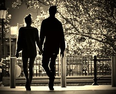Silhouette Romance (missgeok) Tags: lighting people monochrome beautiful sepia backlight composition walking spectacular focus mood artistic candid sydney creative streetphotography silhouettes australia streetscene scene romance lovers together romantic holdinghands framing youngcouple 2people manandwoman candidshot streetcapture nikond90 silhouetteromance