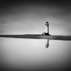ISOLATED. (Neil Hulme.) Tags: longexposure sea portrait blackandwhite lighthouse white motion black water monochrome lumix mono minimalist ndfilter seaandshore nd110filter blackandwhitelongexposure seaandseashore