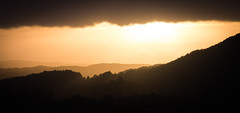Sundown (Kevin A. Smilden) Tags: sunset sky orange sun mountains color silhouette yellow norway clouds canon dark landscape photography photo sundown bergen godrays 650d