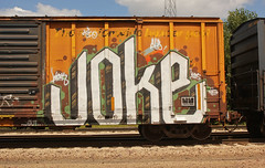 JOKE (The Braindead) Tags: art minnesota train bench photography graffiti painted tracks minneapolis rail explore beyond the
