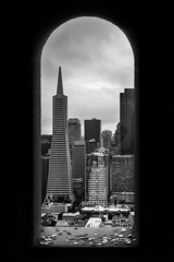 Metropolis (Taha Dar) Tags: city urban blackandwhite bw usa west tower america buildings landscape us san cityscape pyramid pacific coins bank metropolis scenes metropolitan fransisco