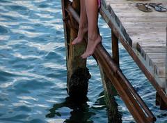 timeless (s_lverspring) Tags: sea summer pier solitude legs dream calm barefoot timeless
